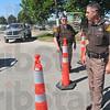 Police presence: Sheriff's Lt's Steve Barnhart and Tim Osborn work the scheid diesel event Friday afternoon.