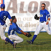 Tribune-Star/Jim Avelis<br /> Meeting place: Ronnie Mitchell, center, catches a fly ball between teammates Jordan Pearson(2) and Nick Johnson.