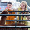 Alpaca pet: Thirteen-year-olds Marshall residents Kai Durflinger and Jacquline Anderson attempt to pet an alpaca on display at the All America Night event on the Marshall square Friday evening.