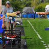 Tribune-Star/Jim Avelis<br /> Think fast: Indiana State University football team equipment manager Kendall Hawkins fires footballs through a Jugs machine to wide reciever Justin Hilton at the start of practice Friday afternoon.