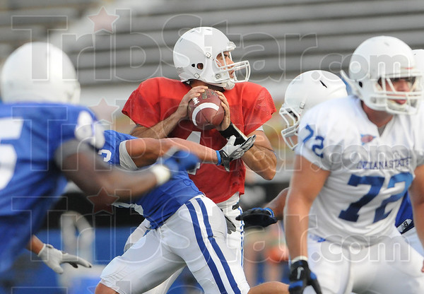 Tribune-Star/Rachel Keyes<br /> Quick look: Indiana State quarter back Ronnie Fouch takes a quick look down the field in a scrimmage Saturday.