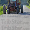 Tribune-Star/Jim Avelis<br /> Road work: Ethan Wyrick travels from one of his plot back home late last week.