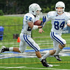 Confusing: Indiana State's #24, George Cheeseborough carries the ball during Saturday's scrimmage game. He's being defended by #84, Cory Little.