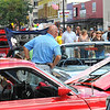 Car crowd: Several hundred people pack Wabash Avenue as they walk along looking at the car show entries and booths during the Block Party.