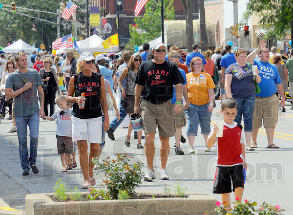 Coming and going: Pedestrians pack Wabash Avenue during Saturday's Block Party event.