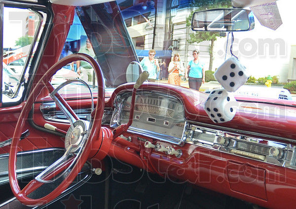 Car show: Block Party goers cruise Wabash Avenue looking at the collection of cars on display Saturday afternoon. `
