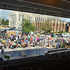 Garage view: Several hundred people watch a street performance during Saturday's block party.