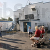 Post people: A group of Post 346 members and employees gather at the rear of the Post after Wednesday's fire.