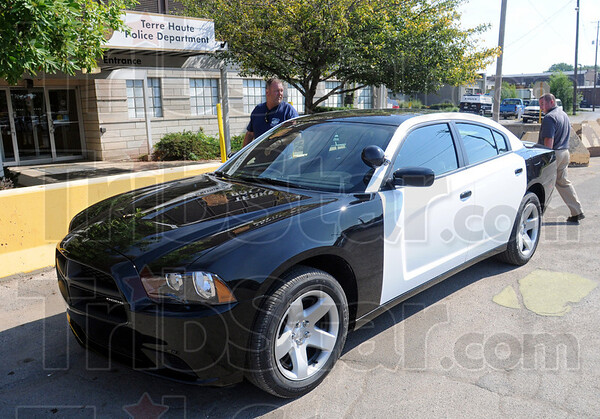 Delivery: Mark May (L) delivers the new car to police headquarters Wednesday morning. The new unit will replace the retired car of officer Brent Long.