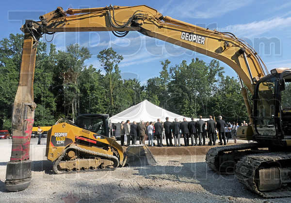 Construction: Dignitaries gather to break ground at the site of the new dormatory on the Rose-Hulman campus Wednesday morning.