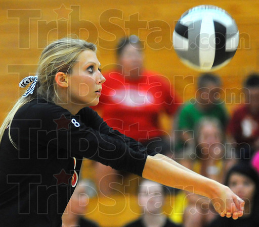 Tribune-Star/Jim Avelis<br /> Defense: Terre Haute South's Brittney Pink bumps the ball to a teammate in their match with Owen Valley.