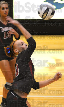 Tribune-Star/Jim Avelis<br /> Old name, new face: Northview's Mikayla Rowan spikes at the net against Terre Haute North.