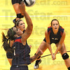 Tribune-Star/Jim Avelis<br /> Spike: Terre Haute North's Danielle Krupa spikes the ball while teammates watch.