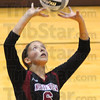 Tribune-Star/Jim Avelis<br /> Set: Northview's Taylor Hess sets up a teammate in the Knights match with visiting Terre Haute North Thursday evening.