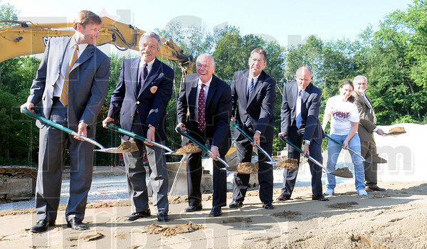 Ground breaking: Dignitaries take a bite of dirt to break ground for the new dormatory to be built on the Rose-Hulman campus Wednesday morning.