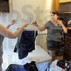 Hang-up: West Lafayette resident Rachael Wilson (L) hands clothing to her mother Rebecca as they move into her Lincoln Quad room Monday afternoon.