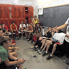 Locker room: Terre Haute South cross country coach Kyle Walsh (R) talks with his team prior to Monday's workout.