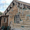 Melted: Siding on the rear of the house at 319 Edwards street was melted from the heat of the flames from an out-building on the property.