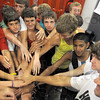 """Give that man a hand: South cross country coach Kyle Walsh (lower right) takes the """"hands on"""" approach to motivate his team prior to Monday night's workout."""