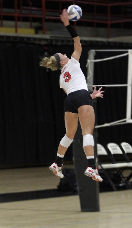 Lauren Evans, 3, hits the ball.