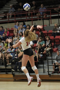 Molly Rhyne, 10, serves the ball.