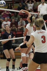 Laura Wilcox, 5, spikes the ball over the net.