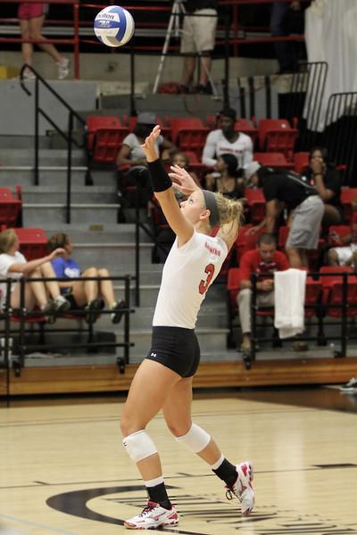 Lauren Evans, 3, serves the ball.