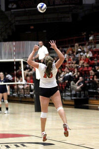 Emily Holte, 15, serves the ball.