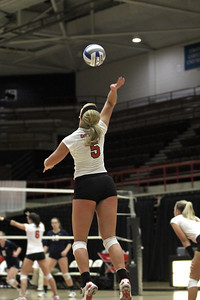 Laura Wilcox, 5,  serves the ball.