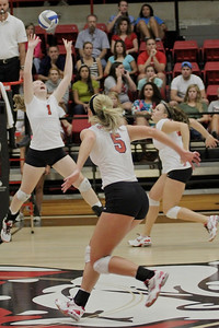 Laura Wilcox, 5, prepares to spike the ball as Heather Feldman, 1, sets it for her.