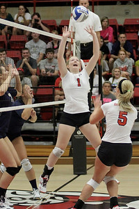 Heather Feldman, 1, sets the ball.