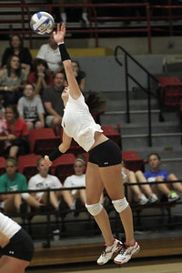 Carol Solano, 6, serves the ball.