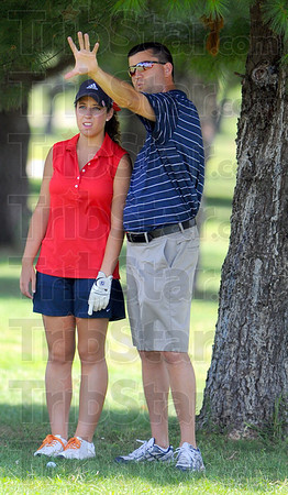 Tribune-Star/Jim Avelis<br /> Guidance: Terre Haute North golfer Courtney Huffenberger gets somne guidance from her coach Abe Nasser .