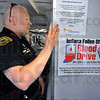Tribune-Star/Jim Avelis<br /> Waiting: Terre Haute police officer Pete Horstman waits his turn to donate blood in the Fallen Officer blood drive.