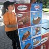 Selection: Sharon Crabb works the ice cream bar at Dede Plaza Tuesday afternoon. All ice cream bars were just one dollar for the day.