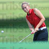 Tribune-Star/Jim Avelis<br /> Close in: Terre Haute South golfer Morgan Patterson chips to the #8 green in the invitational golf match hosted by her school.
