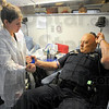 Tribune-Star/Jim Avelis<br /> Giving: Phlebotomist Kylee Wood starts Terre Haute police officer Pete Horstman in the process of donating a pint of blood Tuesday afternoon.