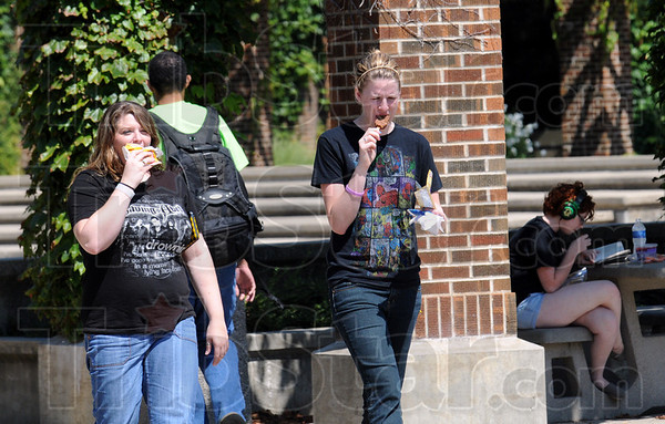 Treat: Indiana State University students Kristi Lawson and Sarah McKnight walk across Dede Plaza eating ice cream Tuesday afternoon.