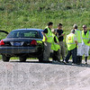 Landfill search: Police personnel talk with landfill employees Tuesday morning at the Sycamore Ridge Landfill in Vigo County. They are searching for IU student Lauren Spierer.