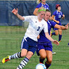 Tribune-Star/Jim Avelis<br /> Nothing's easy: Terre haute North's Amanda Loebker fights for control of the ball with Allexis Mahurin of Sullivan in their tuesday eveing match on the Patriot's pitch.