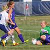 Tribune-Star/Jim Avelis<br /> Stopper: Sullivan goalie Cobie Harrison corrals a shot by Terre Haute North's Amanda Loebker while Golden Arrow Kylee Wills watches.