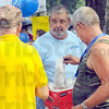 Tribune-Star/Jim Avelis<br /> Popcorn patrol: Mike Grayless of the Vigo County Health Department hands out bags of popcorn to visitors to the National Night Out event at Fairbanks Park Tuesday evening.