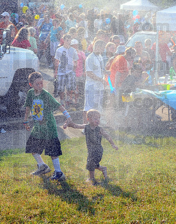 Tribune-Star/Jim Avelis<br /> Cool down: Free water, popcicles, soft drinks and misting stations were available at the National Night out to help visitors deal with teh heat.