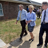Tribune-Star/Jim Avelis<br /> First finish: Indiana Lt. Governor Becky Skillman walks between Tim Fagg, CEO of the Light House Mission and Cliff Lambert, Executive Director of Department of Redevelopment. Skillman was in town recognizing Terre Haute as the first Indiana city to finish some aspect of the Neighborhood Stabilization Project. Some of the dwellings can be seen in the background.
