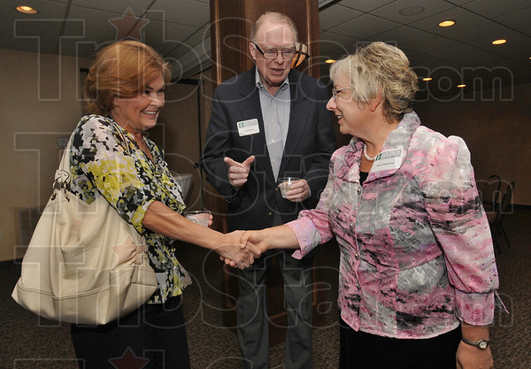 Tribune-Star/Jim Avelis<br /> Welcome: Ivy Tech Community College Wabash Valley Board member Fred Rubey, center, introduces Kristi Loveless, left, of Terre Haute Savings Bank to Dr. Ann M. Valentine, new Chancellor of the college.