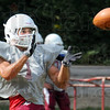 Receiver: Rose-Hulman's #1 hauls in a pass during drills at Tuesday's practice.