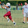 Got it: Rose-Hulman coach Jeff Sokol watches one of his players make a catch during Tuesday's practice.