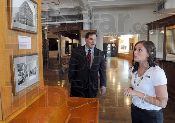 History: Candidate for U.S. Senate, Joe Donnelly gets a quick history lesson about the founding of Hulman and Company from Museum Coordinator Megan Marvin during his Tuesday afternoon visit.