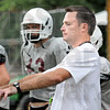 Play call: Coach Jeff Sokol signals to his players during scrimmage action Tuesday afternoon.