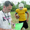 Play: Rose-Hulman coach Jeff Sokol looks at his play list during Tuesday's practice. At right is starting quarterback Mitch Snyder.